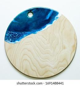 Part of original epoxy resin art close up lacing on wood