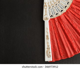 A part of a red hand fan