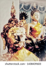 Part of the religious ritual is  bringing gold leaf on the Buddha image. Worshiped by the Buddhists