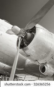 part of a retro of the plane with the propeller closeup in beige tones