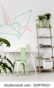 Part of the room white desk with mint chair and decoration made with washi tape on the wall