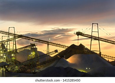 Part of a sand and gravel plant at sunset.