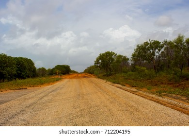 Part of the sealed road on the Dampier Peninsula  eighty kilometers from Broome  to Cape Leveque, North Western Australia on a cloudy late morning in the  December Wet Season after heavy rain.
