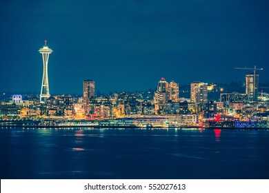 Part of the Seattle Skyline in the State of Washington, United States. Seattle Skyline and the Bay During Night Hours.