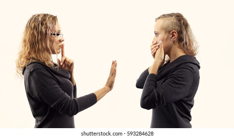 Part of series .Self talk concept. Young blond caucasian woman talking to herself, showing gestures. Double portrait from two different side views.