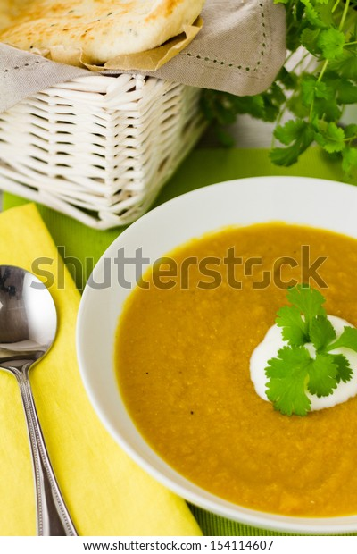 Part of a series showing the preparation of Spiced Carrot and Lentil Soup.