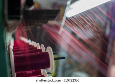 Part of the silk weaving loom with thread reels in Varanasi city. India.