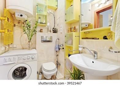 Part of small Modern Bathroom with washing mashine