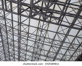 Part of stainless steel construction and transparent roof covered with dust.