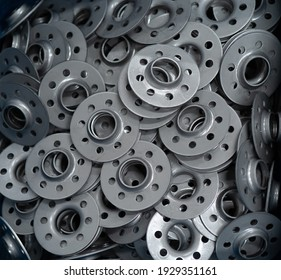 Part of stainless steel metal car seat accessories spare in industry factory store warehouse. Product supplies in engineering. Silver tool raw material. Reflection