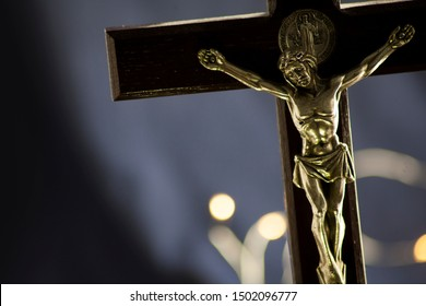 Part of the statuette with the Crucifixion of Jesus Christ, at close range, in the dark, with place for text, without nobody, a symbol of suffering, mercy, sacrifice and God's love