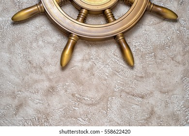 Part of steering weel on a beige background with copy space. Close up top view. Holiday travel conceptual background