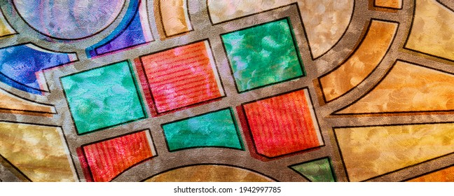 Part of the textured Glowing Glass Art. Backlit hand crafted glass art from church window with flowers and vivid colors. Pattern.