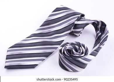 Part of a tie rolled into a spiral isolated