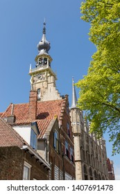 Part of town hall with tower and blue sky in Veere, Netherlands. Veere is popular for tourists.