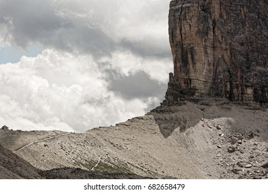 Part of the Tre Cime di Lavaredo and people hiking around on mountain paths