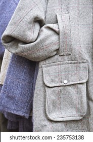 Part of a tweed pattern jacket