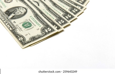 Part of Two dollars bills on background