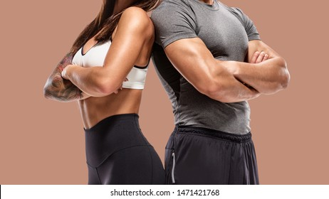 part of Two young athletes posing on brown background