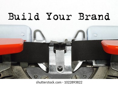 Part of typing machine with typed Build Your Brand words