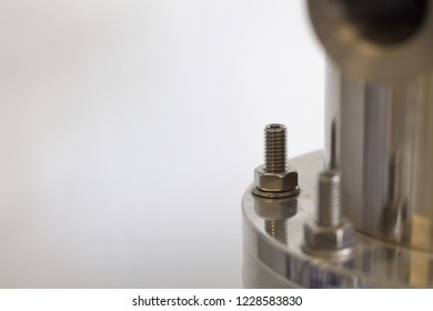 part of vacuum chamber in laboratory, Background/texture of part vacuum chamber, Bolts and screw-nuts on vacuum chamber