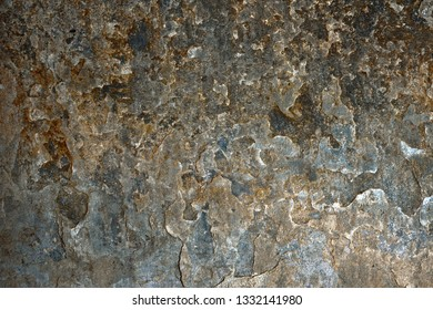 Part of a very worn stone wall as a background