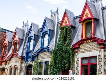 Part of Victorian houses facade, seen from the west side with the color of the roof in Montreal