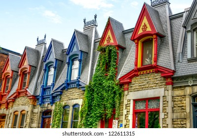 Part of Victorian houses seen from the west side with the color of the roof in Montreal, HDR image