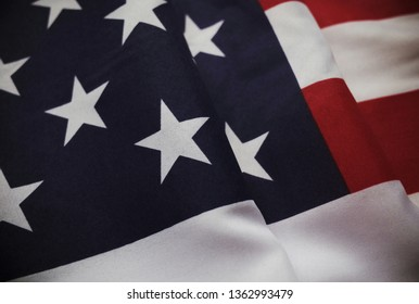 Part view of the stars and stripes flag of the United States of America with vintage colour effects applied