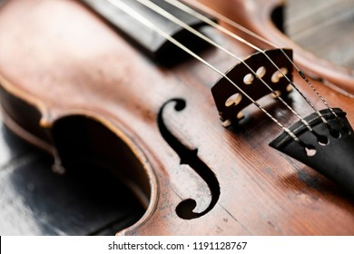 A part of a violin or a viola on a wood background
