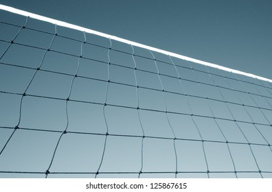 Part of volleyball net against sky