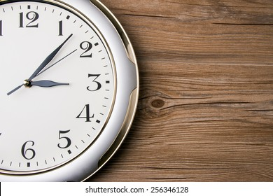 part of a wall clock on wooden background