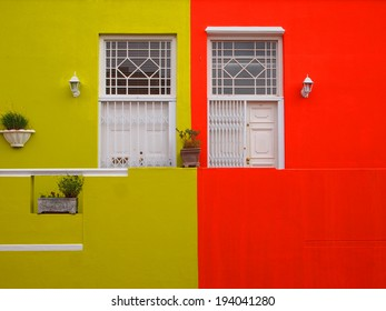 Part of the wall of the house. Doors to balcony. Bright colors. Mustard color and scarlet. Bo-Kaap. Malay Quarter. Cape Town. South Africa