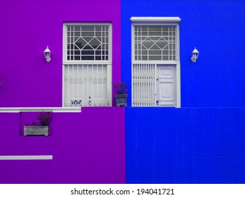 Part of the wall of the house. Doors to balcony. Bright colors. Purple and blue. Bo-Kaap. Malay Quarter. Cape Town. South Africa