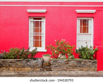 Part of the wall of the house. Windows to balcony. Bright colors. Scarlet. Bo-Kaap. Malay Quarter. Cape Town. South Africa