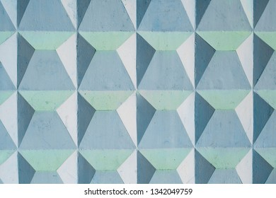 Part of the wall is painted blue with relief squares, triangles, trapezoids