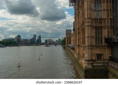 Part of Westminster Palace on the river Thames. Rainy and cloudy weather.