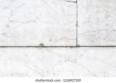 Part of white block wall.