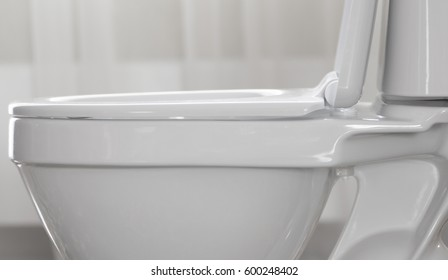 Part Of White Toilet Bowl Close Up.