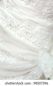 part of the white wedding dress with artificial flowers