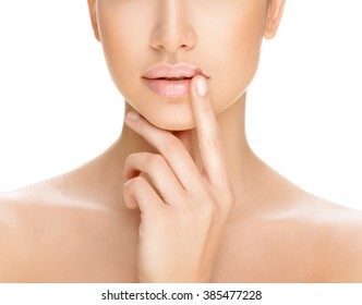 part of a woman's face on a white background, herpes on the lips, beauty concept