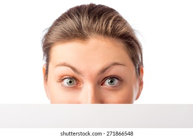 part of a woman's face and white poster on a white background