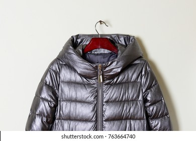 Part of a women's winter jacket with a gray hood, close-up.  Outerwear. Collection of fashionable coverings 2017-2018.