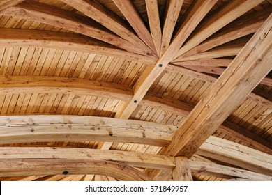 Part of the wooden architecture of the building interior. The wood-paneled ceiling with wooden beams lining. Everywhere is present texture of wood with knots and its own specific structure.