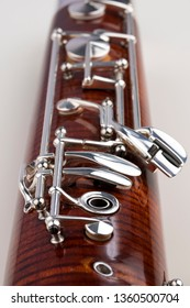 A part of a wooden bassoon. Music instruments.