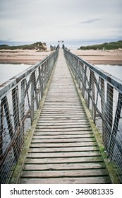 Part of a wooden footbridge over the estuary at Lossiemouth in Scotland