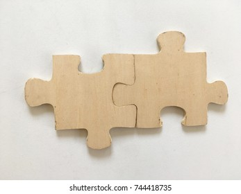 Part of Wooden jigsaw. The background is white.