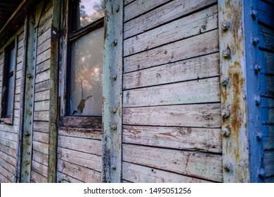 part of a wooden wall with broken Windows