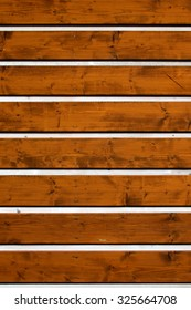 Part of wooden wall made from planks
