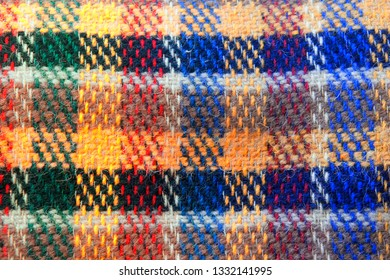 Part of a wool blanket with a tartan pattern